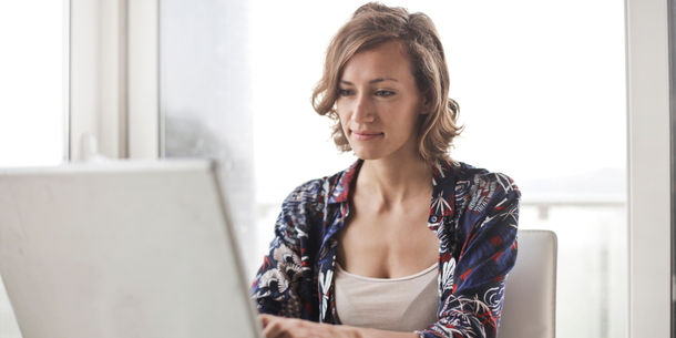 Canva-Woman-in-Blue-Floral-Top-Sitting-While-Using-Laptop-1